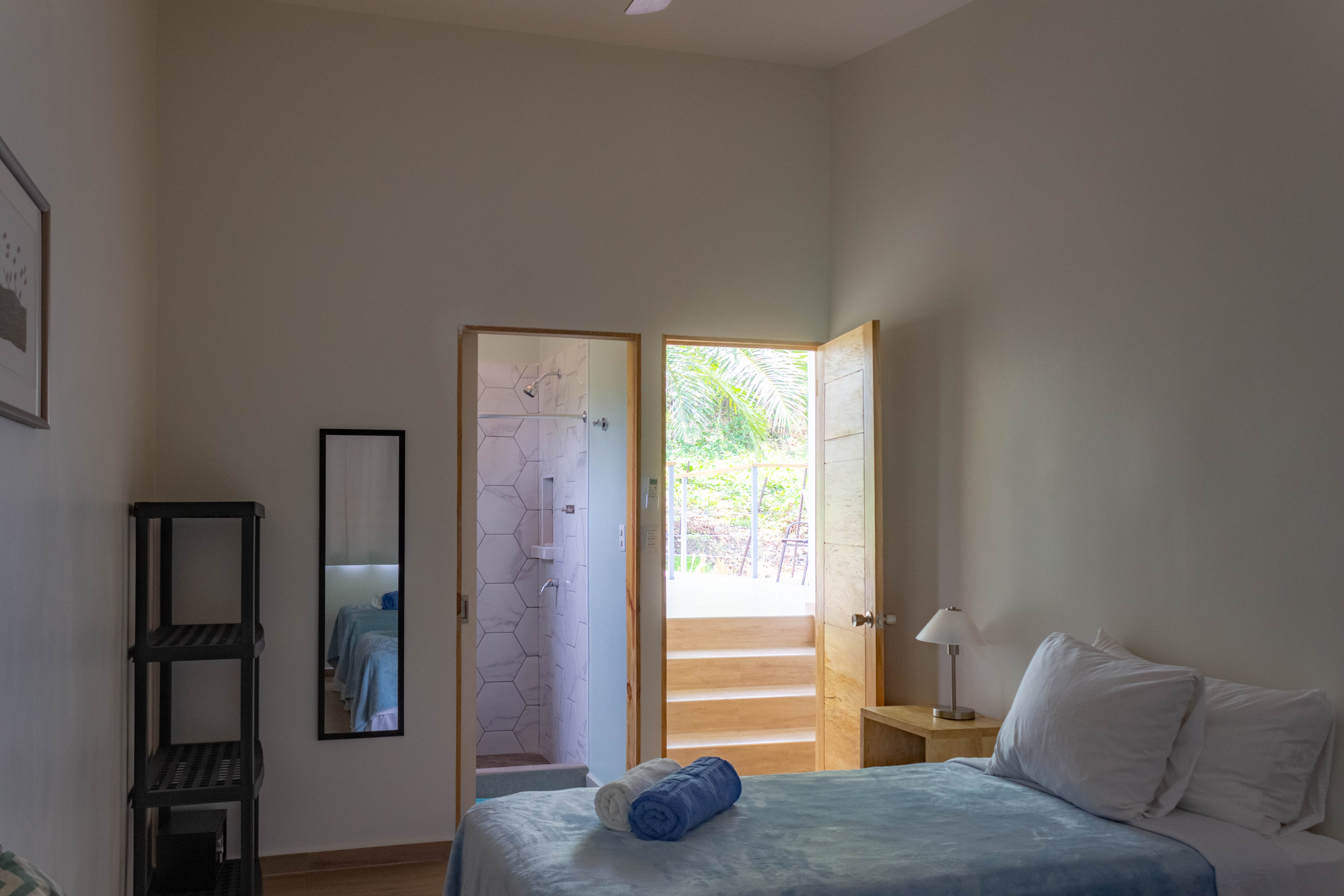 View of the casita's master bedroom looking out onto the patio