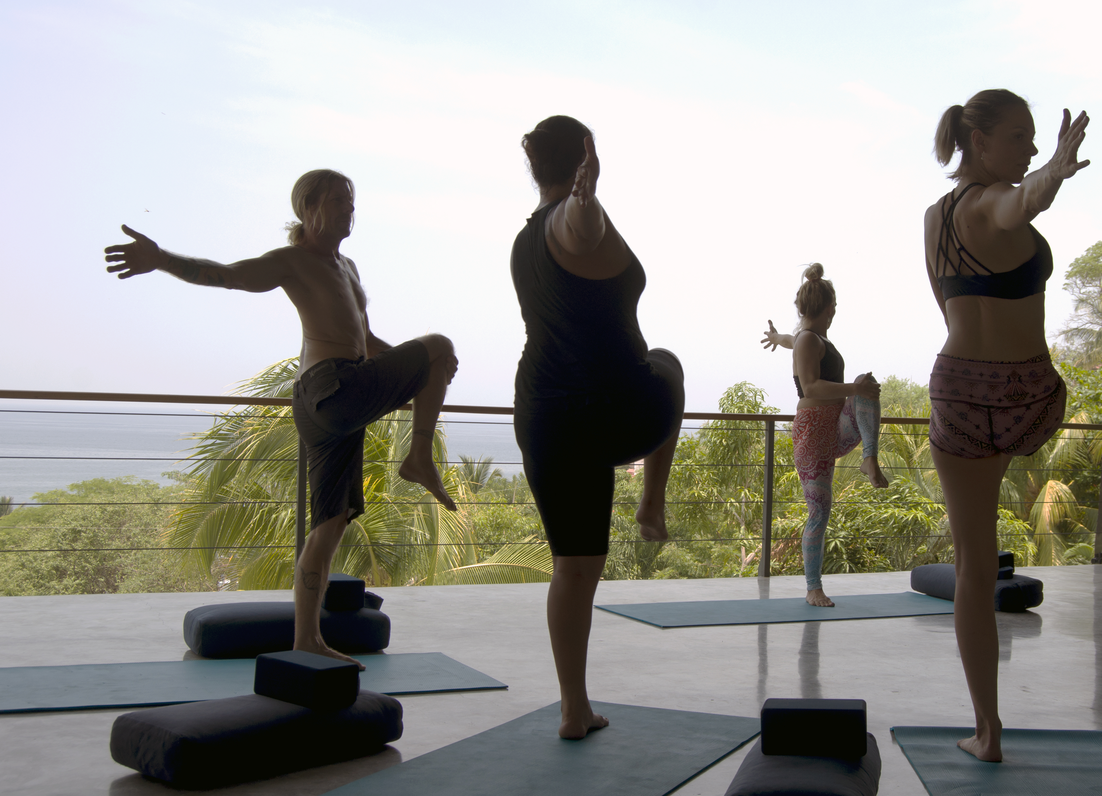 A group of people doing yoga on the yoga deck